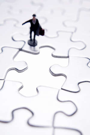 Business figure and puzzle
