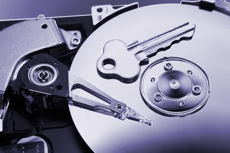 Key on computer hard-drive Stock Photo - 1622871