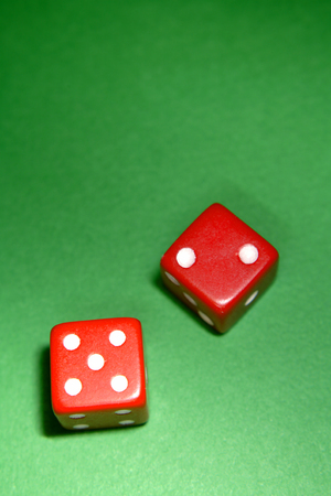 Two red dice on green background Stock Photo - 1622875