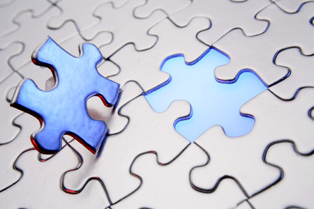 final piece of the puzzle: Final piece of puzzle Stock Photo