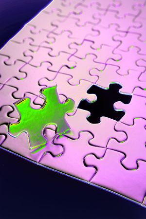 final piece of puzzle: Final piece of puzzle Stock Photo