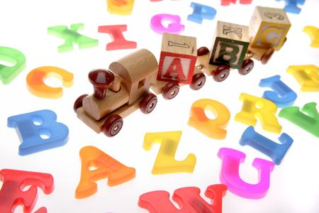 Toy train, learning blocks and alphabet letters photo