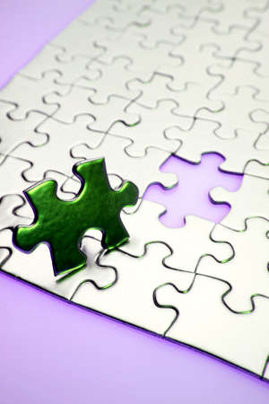 Completing the puzzle Stock Photo - 2085221