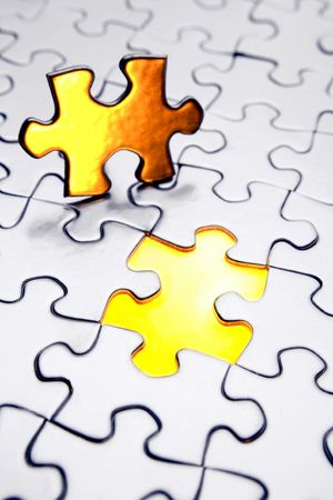 Final piece of puzzle Stock Photo
