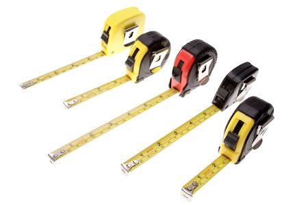 carpenter items: Five tape measures isolated over white