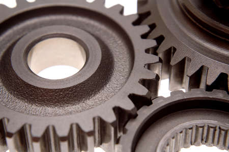 Three gears over white background photo