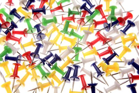 Colorful push-pins over white background photo