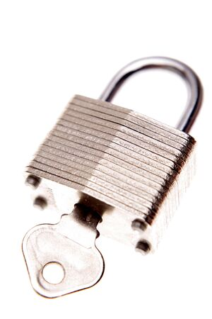 Padlock and key isolated over white Stock Photo - 2163159