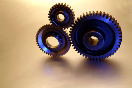 interlink: Three steel cogs connecting together