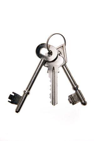Three keys on keyring isolated photo