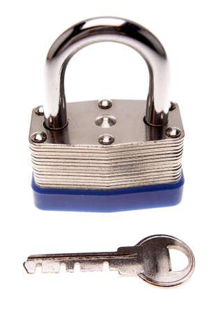 Padlock and key isolated over white photo