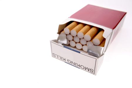 Cigarettes in pack isolated over white photo