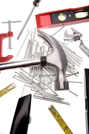 Assorted tools over white background photo