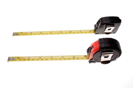 carpenter items: Tape measures isolated over white Stock Photo