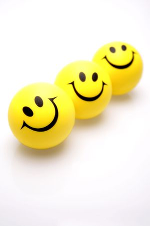 zeal: Three smiley faces over white