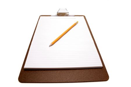 Pencil on clipboard isolated photo