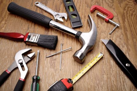 Tools on wooden panel photo