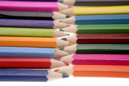 Colored pencils over white background photo