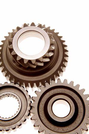 Closeup of three metal gears over white photo