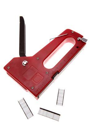 staples: Stapler and staples over white