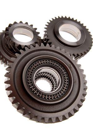 Closeup of three gears over white photo