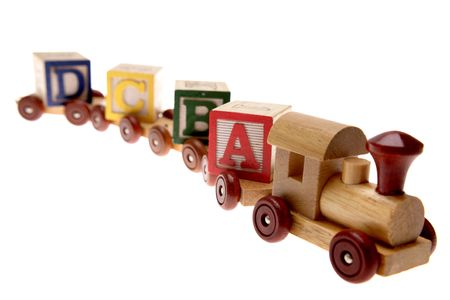 Toy train and learning blocks isolated over white photo