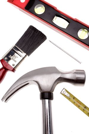 Assorted tools over white photo