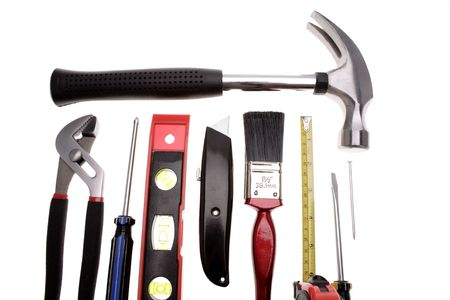 carpenter items: Assorted tools over white