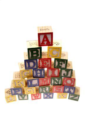 Alphabet learning blocks isolated over white photo
