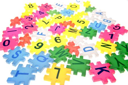 Alphabet letters and numbers over white Stock Photo - 2334863