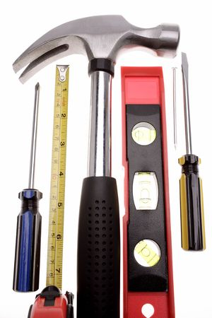 carpenter items: Assorted tools over white background