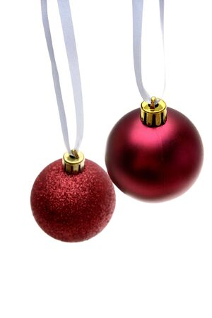 Red Christmas baubles hanging over white Stock Photo - 2344700