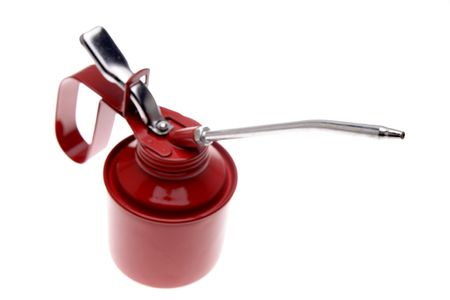 lubricator: Red oil can isolated over white