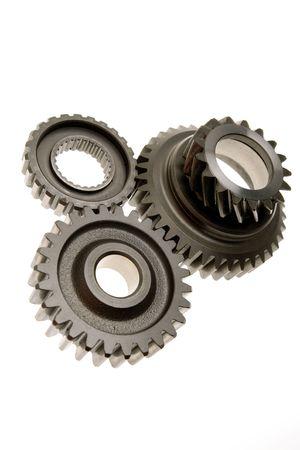 meshing: Three gears meshing together over white Stock Photo