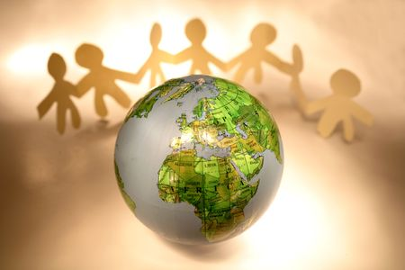 Team holding hands and globe Stock Photo - 2526806