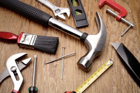 carpenter items: Tools on wooden panel