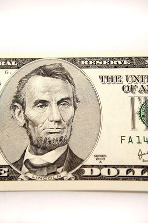 loot: U.S. five dollar banknote Stock Photo