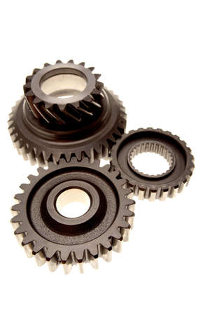 meshing: Three steel gears meshing together over white background