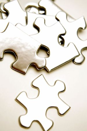Jigsaw puzzle pieces over white Stock Photo - 2614709