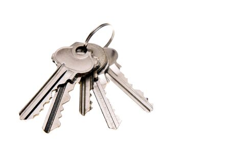 Bunch of keys isolated over white photo