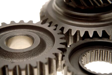 interlink: Closeup of three gears over white Stock Photo