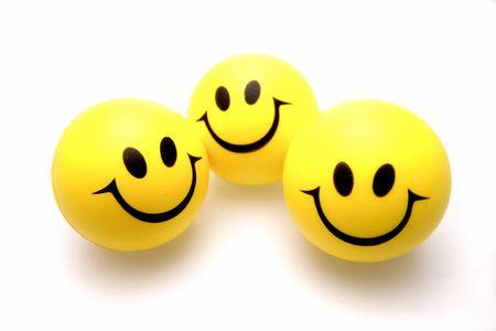smiley faces: Three smiley faces over white