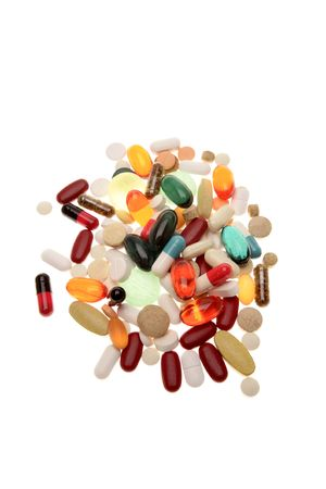 Assorted pills and tablets on white background photo