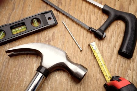 varied: Tools on wooden panel