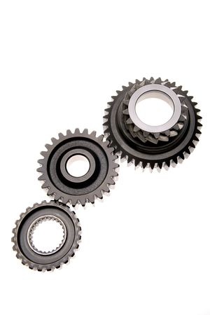 meshing: Three gears meshing together over white background