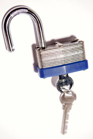 unleash: Open padlock and keys over white Stock Photo