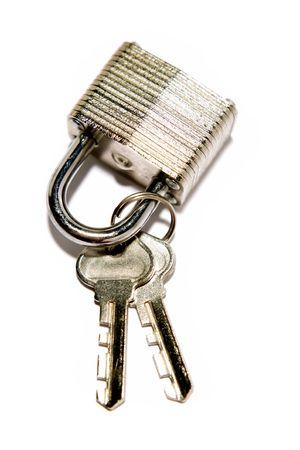 Padlock and keys on white photo