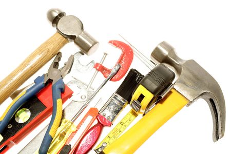 Assortment of tools over white photo