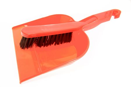 plastic scoop: Brush and dustpan on white background