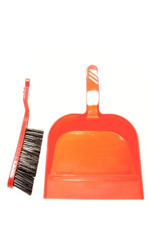 Brush and dustpan on white background photo